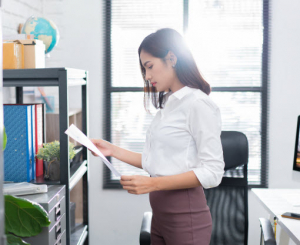 Business woman working with papers in her office