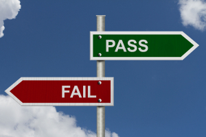 Red and Green street signs with blue sky with words Pass and Fail, Pass versus Fail