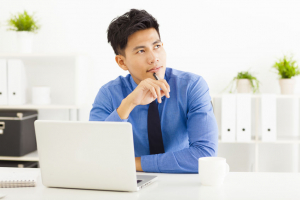 Young asian businessman planning and thinking