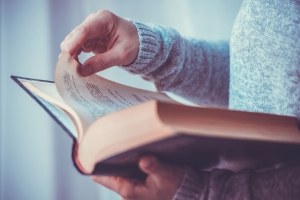 Closeup of a young woman reading a book
