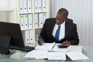 Business man using a calculator in an office