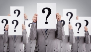 Business people with question marks over faces