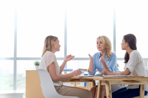 Business women talking at a table