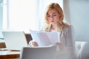 Woman looking at paperwork in her office