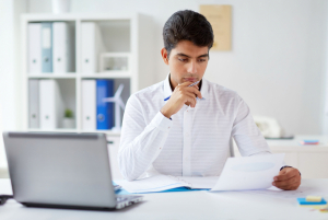 Businessman working with papers in his office