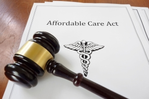 Document titled Affordable Care Act with a judge's gavel resting on top