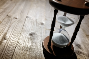 Hourglass on a wooden table