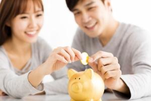 Young Couple Saving Money