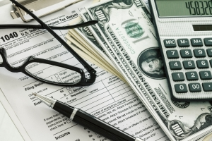 Tax forms with calculator and money
