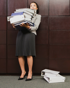 Business lady with a stack of papers