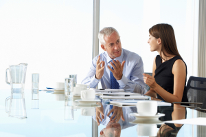 Business man and woman meeting at a conference table